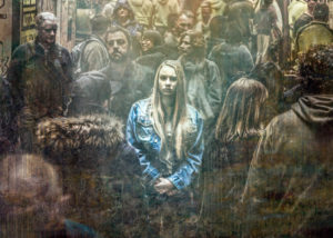 young woman, alone in a crowd